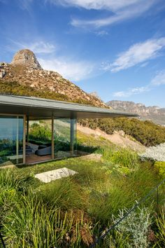 A clifftop home with 360 degree mountain and ocean views