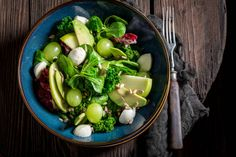 fresh kale salad with mix of vegetables and avocado