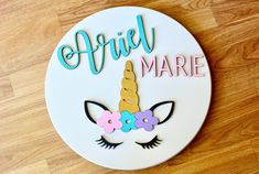 Custom name sign features a handmade, round name sign with a unicorn and flowers. This three-dimensional sign is the perfect addition to your kids room or nursery decor. Wood Name Sign, Wood Names, Name Signs, Bedroom Signs, Nursery Signs, Nursery Decor, Farmhouse Cutting Boards, Unicorn Names, Name Boards