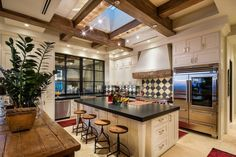 Kitchen features a custom ceiling with exposed joists and a skylight together with wooden accents made from reclaimed wood in this home in Scottsdale, Arizona. [1280 × 853] : RoomPorn