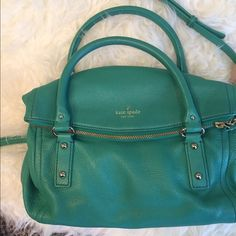 Kate Spade Leather Purse  Great condition. Comes with original dustbag... Lots of pockets inside and magnetic pocket outside. Detachable strap. Soft leather in amazing green color to make any outfit POP! kate spade Bags Shoulder Bags