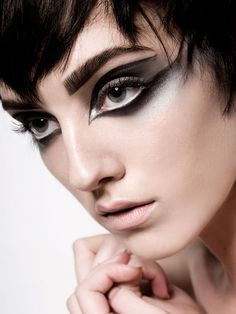 Black graphic eyeliner with silver eyeshadow defined eyebrow and nude lip