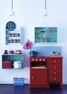 Another ridiculously cute play kitchen.  Think I could pull this together with things from our house.