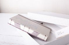 Notebook with raised cords and diagonal tapes by Siuyuett