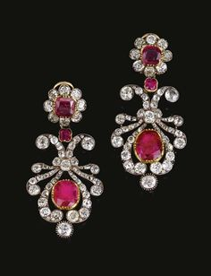 RUBY AND DIAMOND PARURE, 1820S AND LATER. The necklace designed as a series of ribbon scrolls set with, each set to the centre with a cushion-shaped ruby in a cut-down collet and accented with a pair of ruby and diamond florets, interspersed with old-mine diamond trefoil sprigs, length approximately 395mm, accompanied by a tiara frame, a pair of pendent earrings en suite and a ring the flower head motif detachable from ring mount to be worn as the necklace clasp.