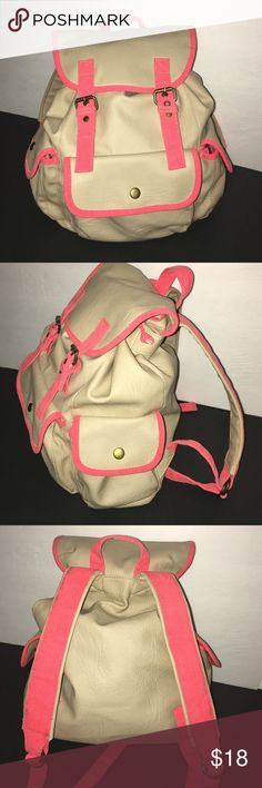 Mossimo Backpack Cute Mossimo backpack. Faux leather, light beige in color with bright coral trimmings. Pocket in front and on both sides. Draw string closing as well as snaps. Mossimo Supply Co Bags Backpacks