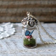 I found 'Tiny Terrarium Necklace Blue Morpho Butterfly and Red Spotted Toadstool Mushroom Glass Vial' on Wish, check it out! Bottle Jewelry, Bottle Charms, Bottle Necklace, Morpho Butterfly, Blue Morpho, Monarch Butterfly, Blue Butterfly, Clay Crafts, Diy And Crafts