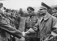 Rudolf Hess shakes hands with German soldiers (1941). Hess (1894-1987) was a prominent politician in Nazi Germany. Appointed Deputy Führer to Adolf Hitler in 1933, he served in this position until 1941, when he flew solo to Scotland in an attempt to negotiate peace with the United Kingdom during World War II. He was taken prisoner and eventually was convicted of crimes against peace, serving a life sentence.