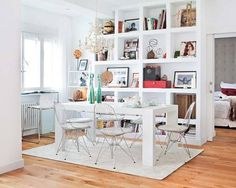 Loving the bookcase/display shelves full of trinkets!