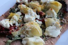 Homemade Artichoke, arugula, goat cheese, sun-dried tomato pizza