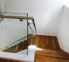 Stainless steel handrail and glass railing Stainless Steel Handrail, Glass Railing, Track Lighting, Stairs, Ceiling Lights, Railings, Modern, Home Decor