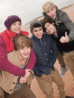 one direction... a bunch of cute guys... who dress well... and sing<3 (=
