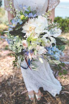 blue and purple bouquet - photo by Hazy Lane Studios http://ruffledblog.com/european-sky-wedding-ideas #weddingbouquet #bouquets