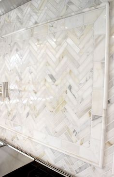 Arabescato Carrara Herringbone Pattern 1x2 Honed backsplash.