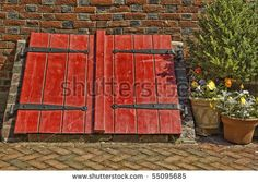 stock photo : Bright Red Old Cellar Doors and Brick Wall