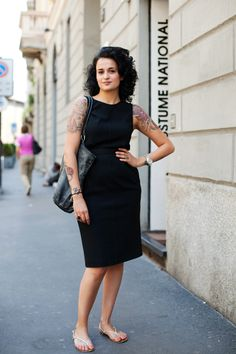 A classic look from the Sartorialist, with a twist.  This woman's partial sleeve tattoos look so feminine and have made me reconsider them as an option for myself.