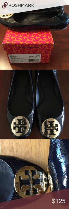 Tori Burch Gold Reva Ballet Flats Navy Patent SZ 7 100% Authentic Tory Burch gold signature logo medallion top Reva flat.  Medallion has a few scratches and patented leather has a few marks...please see pics.  These shoes look so good on! The make every outfit look upscale. Tory Burch Shoes Flats & Loafers