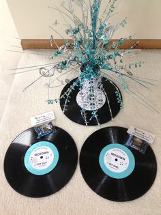 "Motown themed Rehearsal Dinner.  Old records with new labels for plate chargers, centerpieces in wine glasses, and chocolates ""since it is so sweet to be loved by you!""   Beautiful sparkle on the restaurant tables for the Christmas wedding."
