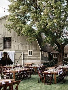Barn wedding with farm tables and cafe lights.