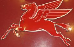 The nine foot cookie cutter Pegasus facing right is VERY RARE. I personally pulled this out of the old parts storage room on the second floor of Hannah's garage. Porcelain Signs, Old Signs, Pegasus, Vintage Signs, Cookie Cutters, I Shop, Garage, Neon, Oil