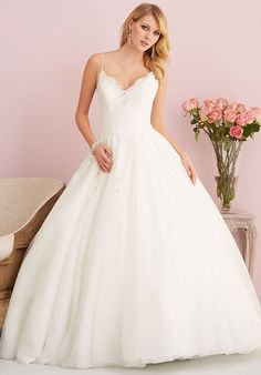 Thin straps, gauzy lace and ethereal tulle compose this gorgeously simple ballgown.