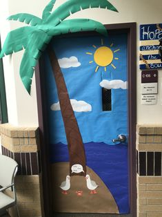 Summer/end of the year door decoration complete with palm tree, sun, clouds, island, 'mine' seagulls and scared crab.