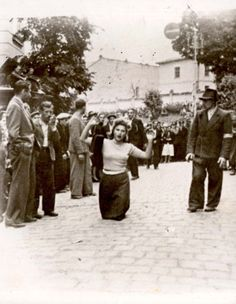 Lviv, Ukraine, A woman forced to kneel with her raised hands, 30/06/1941-03/07/1941.