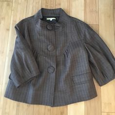 Gianni Bini Cropped Wool Blend Jacket Adorable! 3/4 length sleeves. Perfect for the office or with jeans and heels. Fully lined. Wool blend. Snap front under giant buttons. Excellent used condition with no signs of wear. From Dillard's. Gianni Bini Jackets & Coats Blazers