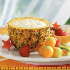 Fruit dip inside hollowed pineapple with fruit kebobs?