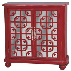 This hand painted distressed red and mirrored finish accent chest features two functional doors for storage with an adjustable shelf inside. The chest offers elegant antique nickel finished hardware.