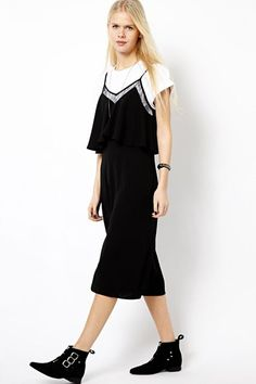 Tone down a traditionally seductive dress by layering it with a plain, white tee and take-me-anywhere, flat boots.  #refinery29 http://www.refinery29.com/69023#slide-4