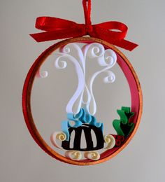 Quilled Christmas ornament celebrating the traditional lighting of the plum pudding / figgy pudding.
