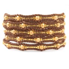 Chan Luu - Yellow Gold Scalloped Wrap Bracelet on Natural Brown Leather, $245.00 (http://www.chanluu.com/wrap-bracelets/yellow-gold-scalloped-wrap-bracelet-on-natural-brown-leather/)