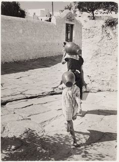 Woman and girl carrying amphorae, Mikonos, Greece,  1951 by David Seymour