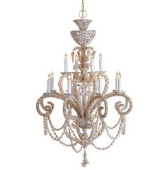 Bring the beach inside your home with this grand, handmade, all natural twelve light chandelier.  With miniature shells encasing the scrolled arms and draped shells encompasing the entire fixture, it is certainly a vision from the sea.  Exquisite in a natural white, this chandelier adds sophistication and whimsy to any room.