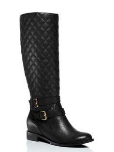inspired, in part, by the classic horse-riding uniform, these knee-high double-buckle boots are remarkably versatile; play up the equestrian vibe with a pair of thick leggings and a blazer, or use them to ground a flow-y, patterned dress.
