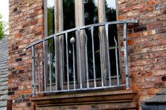 Contemporary wrought iron juliet balcony.  http://www.verdigrismetals.co.uk/index.htm