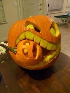Carve a worried looking mini pumpkin and size it to fit the mouth of a larger and hungrier pumkin! Kids love this one!