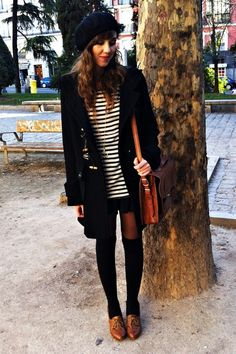 brown oxfords with black over the knee socks.