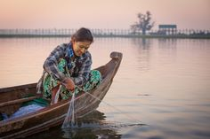 In the early morning local fishers - many of them husband and wife teams -  are picking up the night´s catch. Photo: John Einar Sandvand.  More photos: http://sandvand.net/photography-in-myanmar-meeting-the-sun-at-u-bein-bridge/