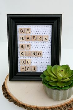 be happy scrabble frame - they glue the letters onto the glass...