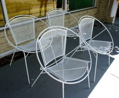 Salterini Hoop Mid Century Patio Chair- A few chairs like these on the deck might bring sculptural presence and personality- especially in a color