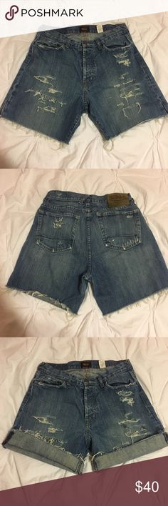 """Von Dutch Distressed High Waisted Cut Off Shorts Authentic Von Dutch. Button fly. Distressing. Inseam is cut to about 6"""". These shorts are extremely comfortable and worn in. Marked as a waist 32, but fit much smaller. Look great worn high waisted! Would best suit a size 6. They give off a very grungy vibe and are perfect to pair with any summer outfit. Look super cute rolled up as well and will only get better with age! Von Dutch Shorts Jean Shorts"""