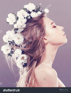 Beautiful young woman with delicate flowers in their hair, instagram filters
