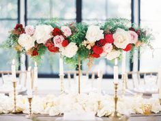 Pink, red and white rose centerpiece idea -- but I would have mine lower, in shorter vases.
