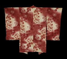 A silk haori (woman's jacket) features camellias that are worked into both the rinzu background and the dyed foreground. There is some surihaku gold-foil outlining. Taisho to early Showa period (1912-1940)