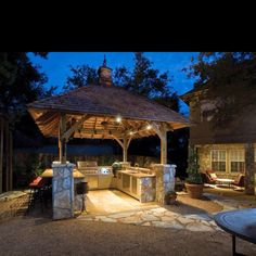 Outside kitchen and grill; wrapped with stone on front & stucco inside.