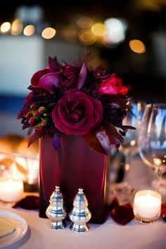Wine/burgundy flowers in a square glass vase.  However, vases can be expensive.  Why not use a sturdy, elegant paper gift bag. #Brides Rock Workshops: Inexpensive DIY Elegance. www.bridesrockbridalexpos.com