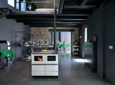 """Palazzetti new stoves - Bella idro 20 kw , hydronic pellet range cooker that works like a real boiler while it cooks, top or side stovepipe fitting, connection Box that allows the remote control of the appliance by using the """"Palazzetti APP"""" on your mobile phone,digital display with touch controls."""
