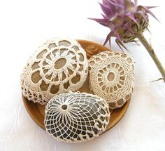 """doilies sewed around rocks - simple...cute addition to a centerpiece or to give a little """"umph"""" to cake/gift/food table"""